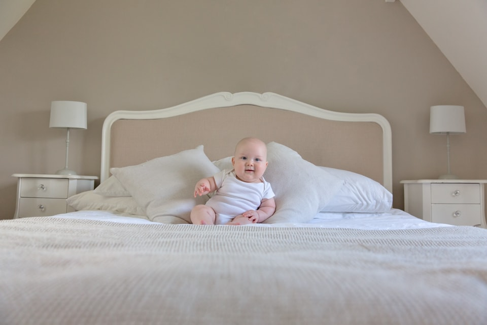 baby on a double bed