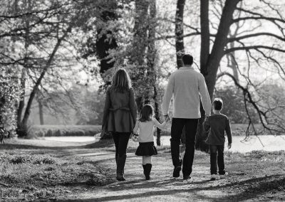 Family of four walking away from camera by Northampton family photographer