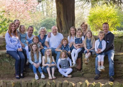 Extended family photoshoot in Northampton, family all wearing blue and white outfits