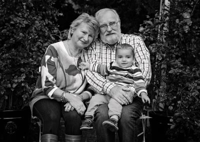 Grandparents holding baby boy at home photoshoot in Northampton