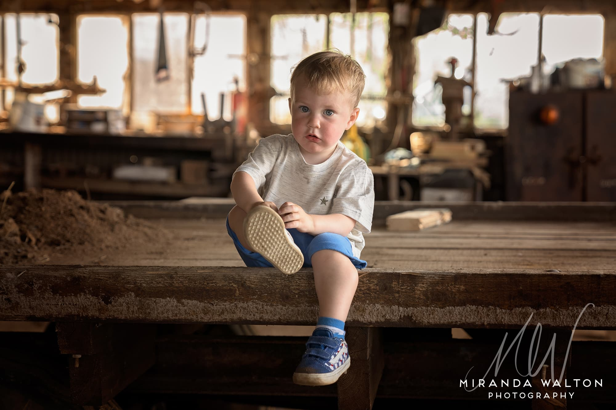 little boy in a farm workshop