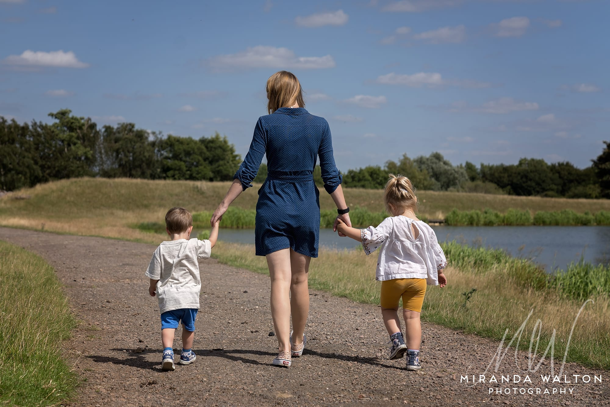 mother walking with two young children